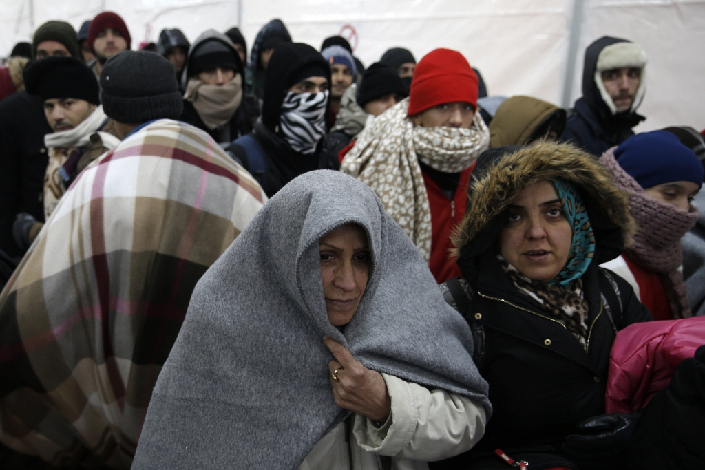 Migrants wait in line inside a registration camp in Presevo, Serbia, on January 20, 2016. REUTERS / Marko Djurica