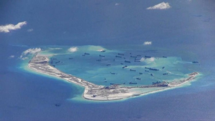 Chinese dredging vessels are purportedly seen in the waters around Mischief Reef in the disputed Spratly Islands in the South China Sea in this still image from video taken by a P-8A Poseidon surveillance aircraft provided by the United States Navy on May 21, 2015. REUTERS / U.S. Navy / Handout via Reuters