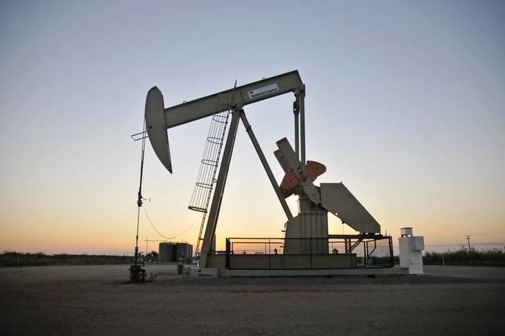 A pump jack operates at a well site leased by Devon Energy Production Company near Guthrie, Oklahoma