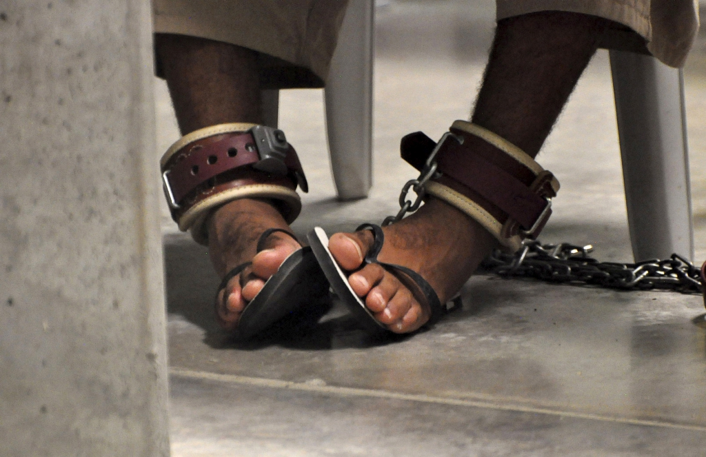 Guantanamo detainee's feet are shackled to the floor