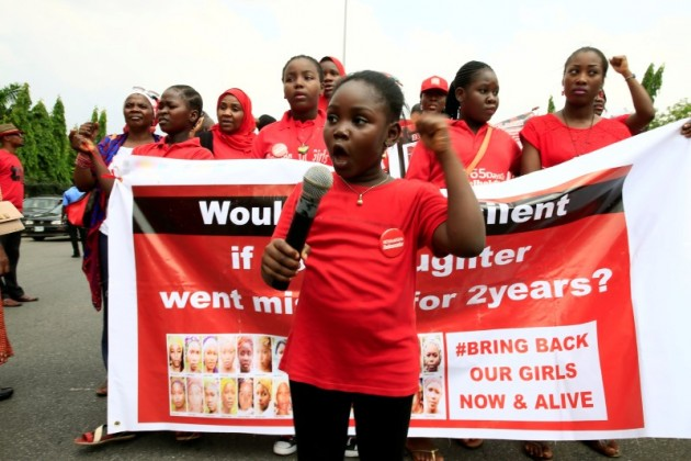 """Bring Back Our Girls"""" campaigner Christabell Ibrahim, 8, speaks during the media conference marking two years from the abduction of the Chibok girls, in Abuja"""