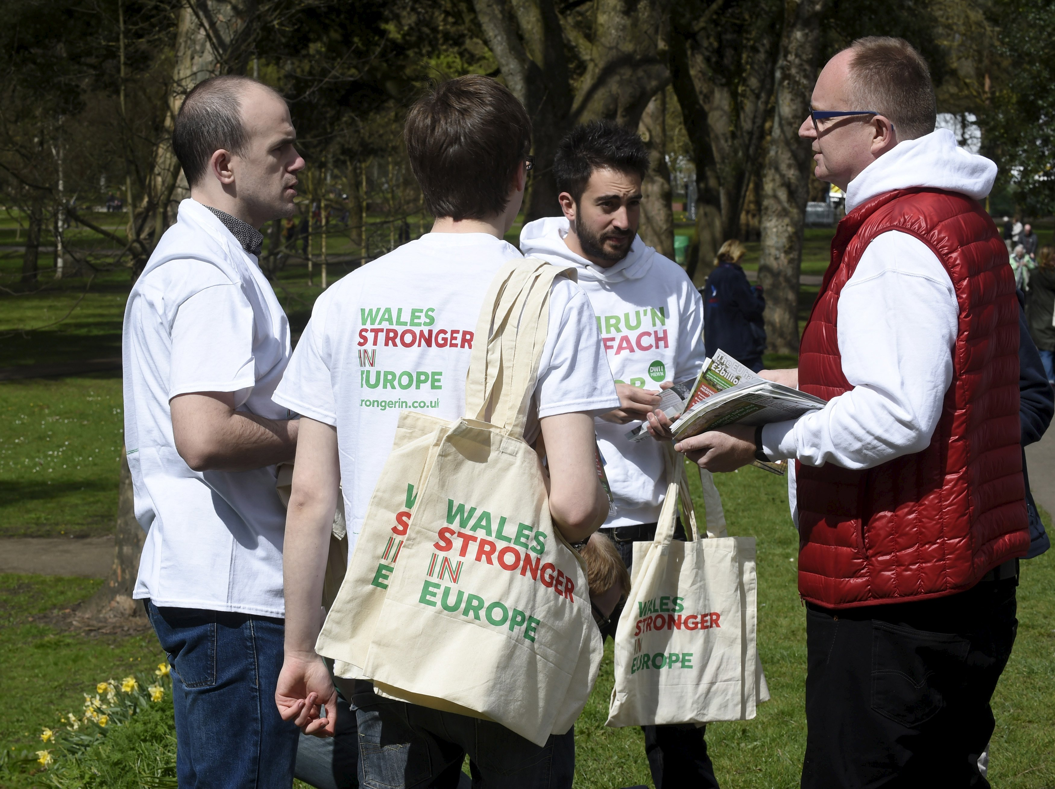 Wales Stronger in Europe supporters prepare to give out free shopping bags and leaflets in Bute Park, Cardiff, South Wales