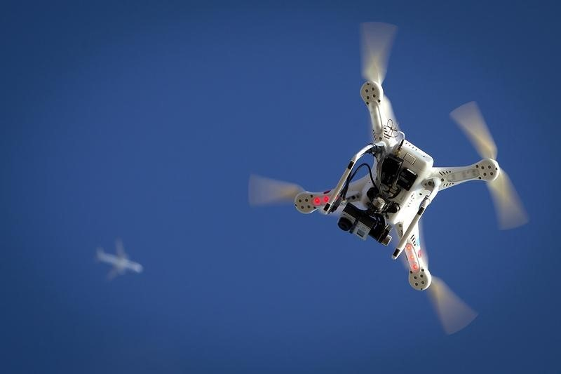Airplane flies over a drone during the Polar Bear Plunge on Coney Island in the Brooklyn borough of New York
