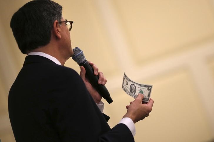 U.S. Treasury Secretary Jack Lew holds a two dollar note as he speaks during an event about currency redesign hosted by the University of Maryland in College Park, Maryland