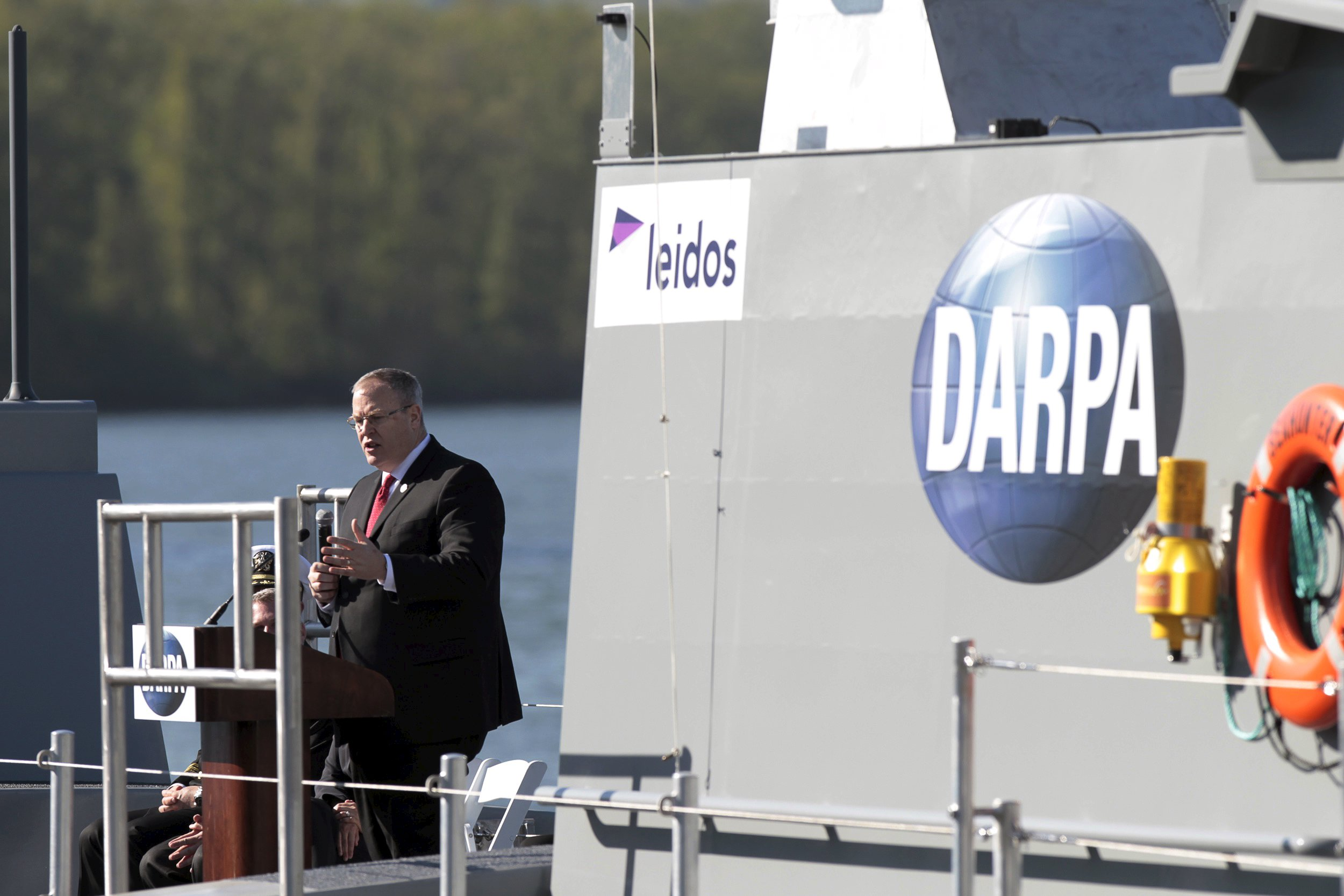 "Robert Work, U.S. Deputy Secretary of Defense, speaks at a christening ceremony for the autonomous ship ""Sea Hunter"", developed by DARPA, in Portland, Oregon"