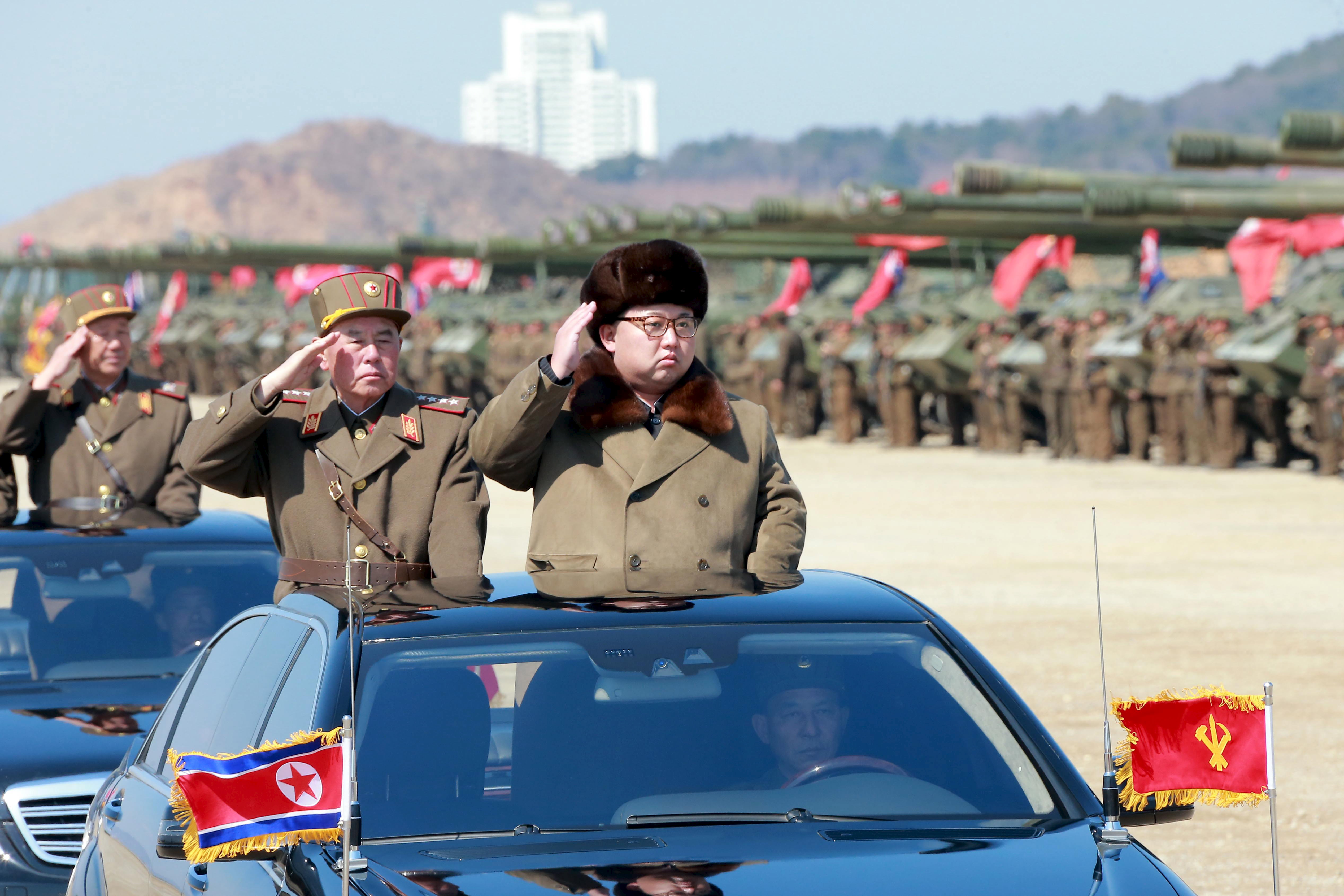 North Korean leader Kim Jong Un salutes as he arrives to inspect a military drill at an unknown location, in this undated photo released by North Korea's Korean Central News Agency (KCNA)