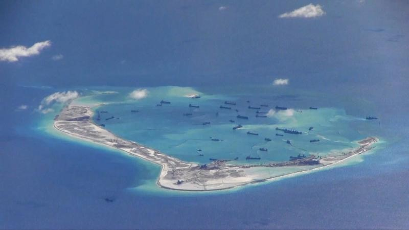 Still image from United States Navy video purportedly shows Chinese dredging vessels in the waters around Mischief Reef in the disputed Spratly