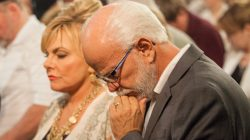 Lori Bakker, Jim Bakker in prayer at Morningside