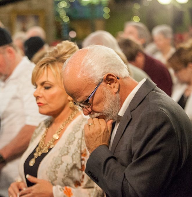 Lori Bakker, Jim Bakker in prayer at Morningside