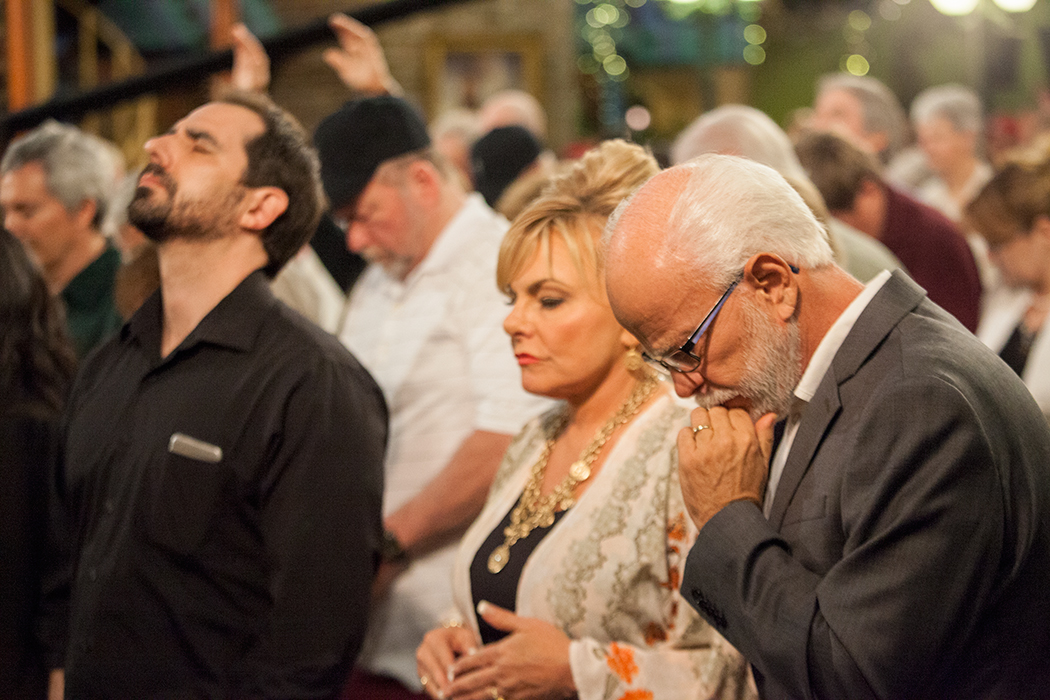 Lori Bakker, Jim Bakker and Joel Richardson in prayer at Morningside