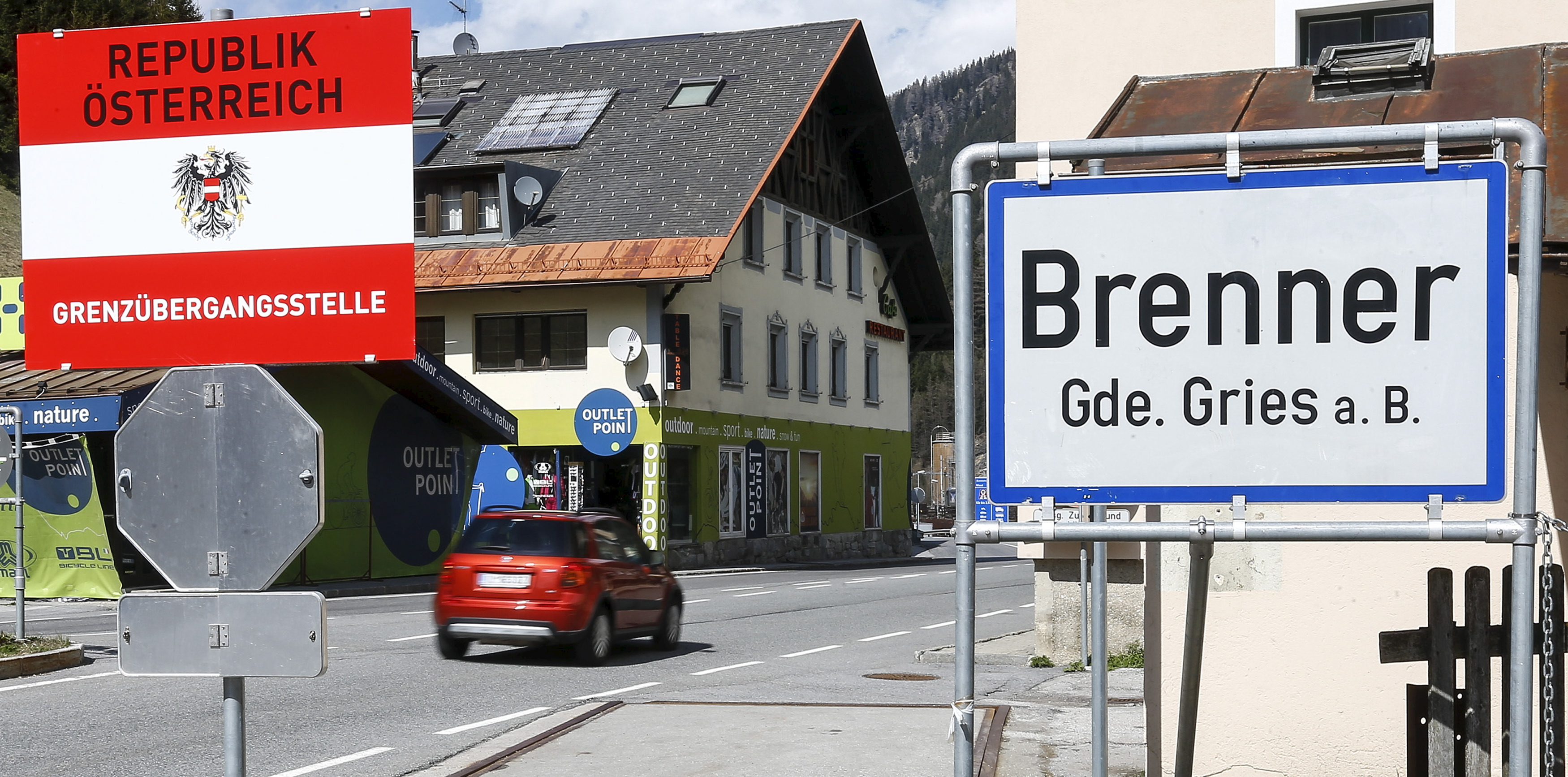 """A sign reading """"Republic of Austria - border control"""" is seen at Brenner on the Italian-Austrian border"""