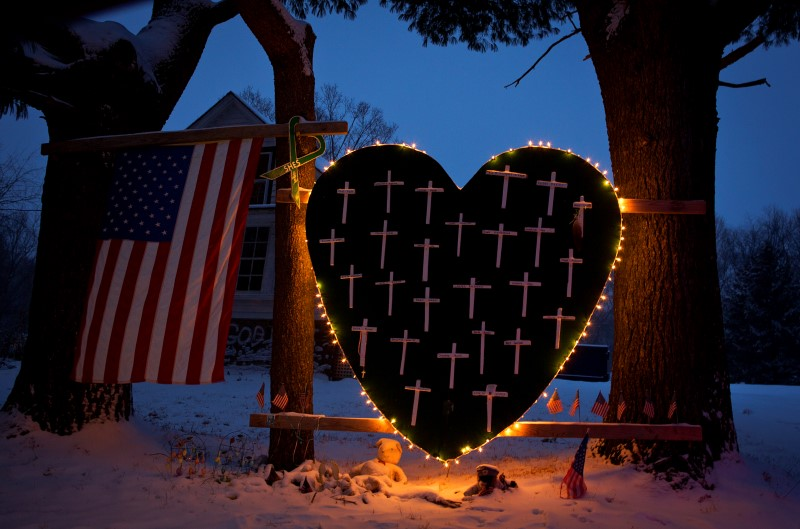 A heart that bears 26 crosses for each victim is surrounded by lights the Sandy Hook portion of
