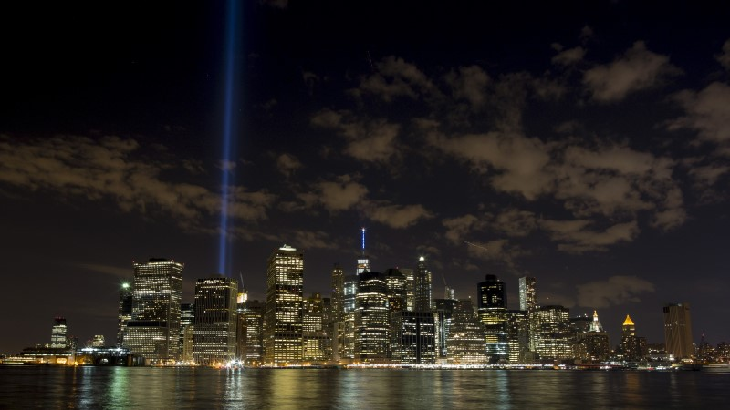 The Tribute in Light installation is illuminated over lower Manhattan as seen from Brooklyn Bridge