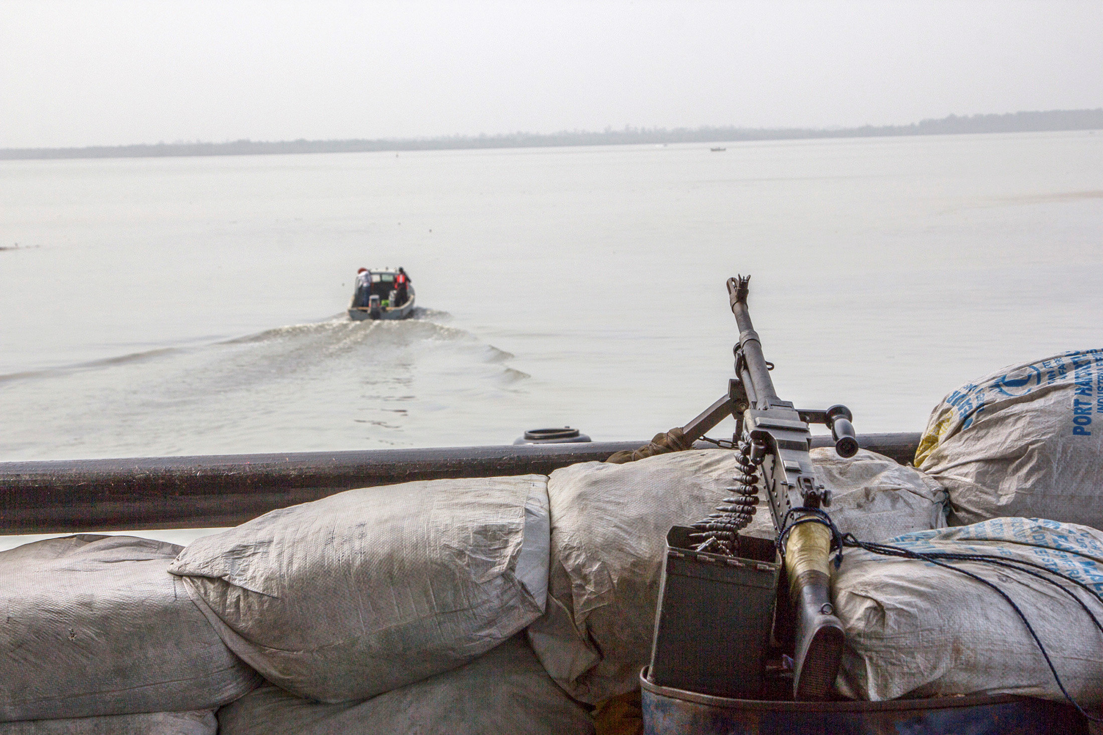 A machine gun is seen on a sandbag on a boat off the Atlantic coast in Nigeria's Bayelsa state