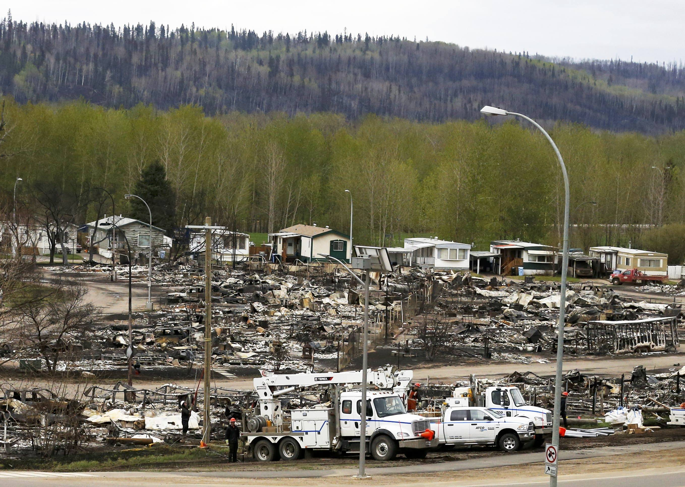 Crews begin to work on the burned out remains of the Waterways neighbourhood of Fort McMurray