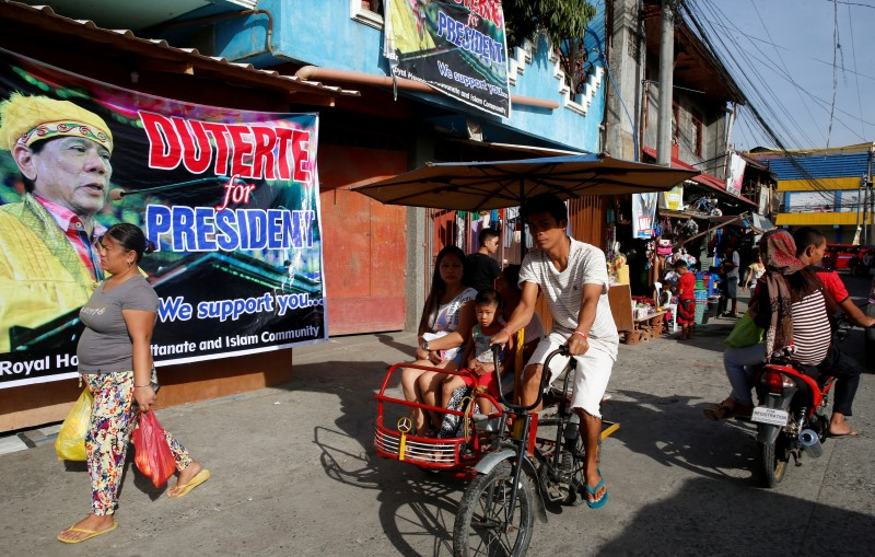 "A poster of presidential candidate Rodrigo ""Digong"" Duterte at a residential district during the national elections in Davao"