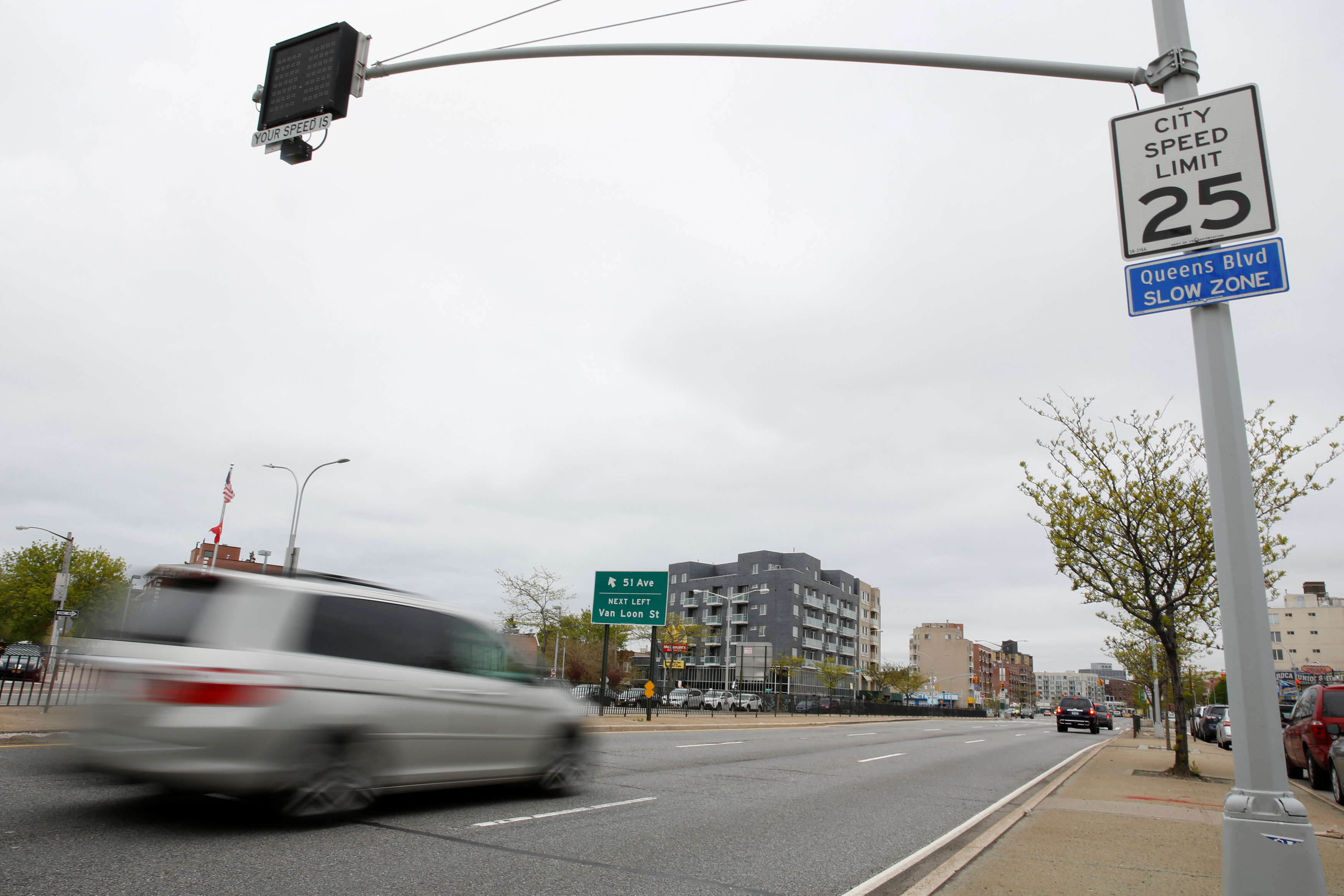 A car is seen driving along Queens Boulevard in the borough of Queens in New York, U.S.,