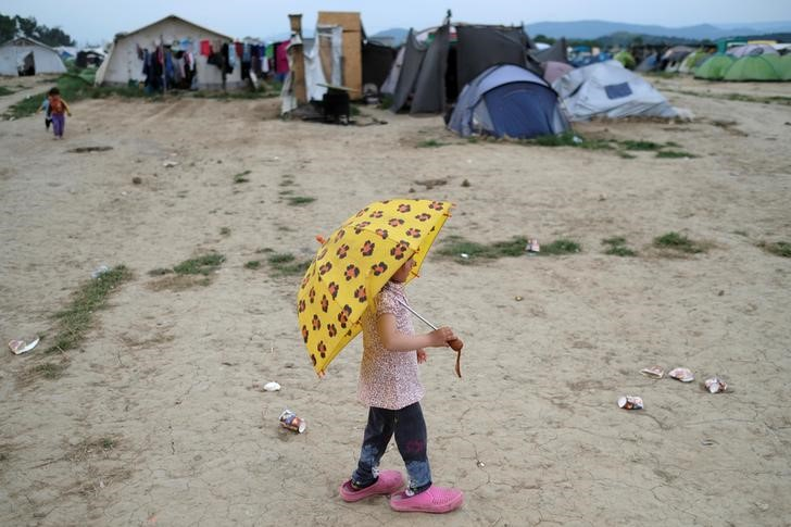 Refugee girl with umbrella