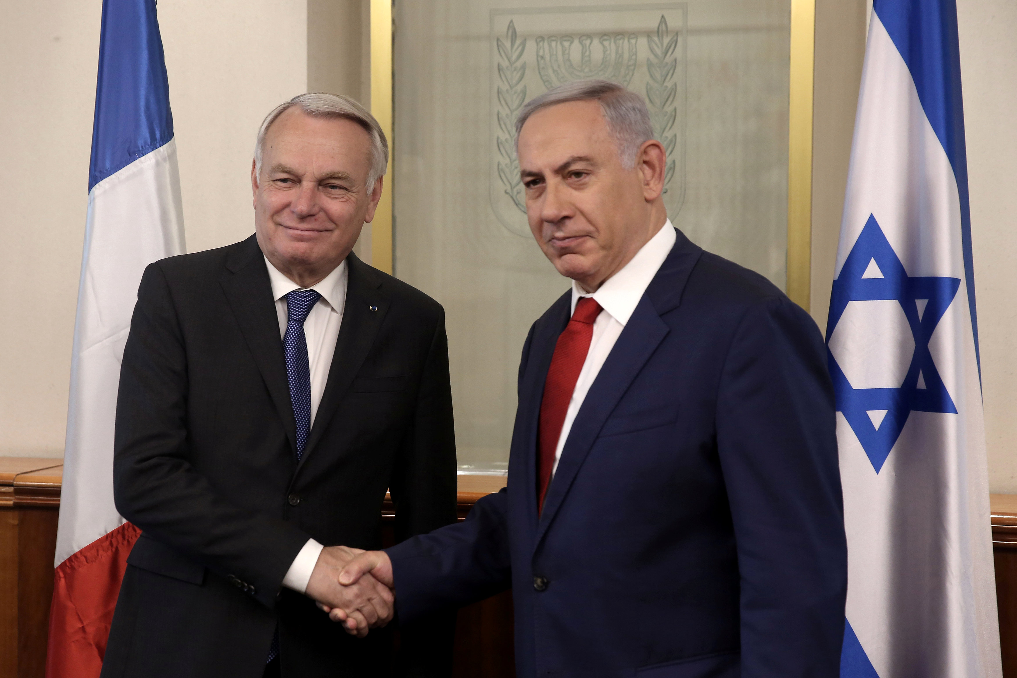Israeli Prime Minister Benjamin Netanyahu shakes hands with French Foreign Minister Jean-Marc Ayrault