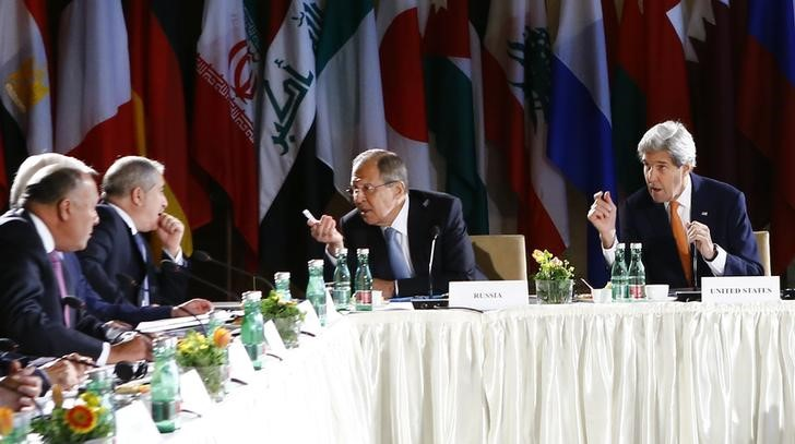 Russian Foreign Minister Sergei Lavrov (2R) and U.S. Secretary of State John Kerry (R) attend the ministerial meeting on Syria in Vienna, Austria, May 17, 2016.