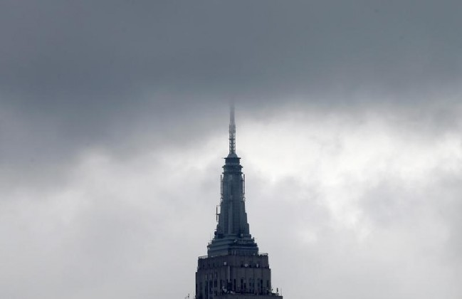 The Empire State Building's spire is shrouded in clouds in Manhattan, New York, U.S., May 3, 2016.
