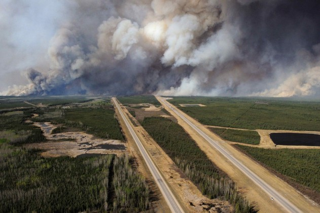 An aerial view of Highway 63 south of Fort McMurray, Alberta. Canada, shows smoke from the wildfires