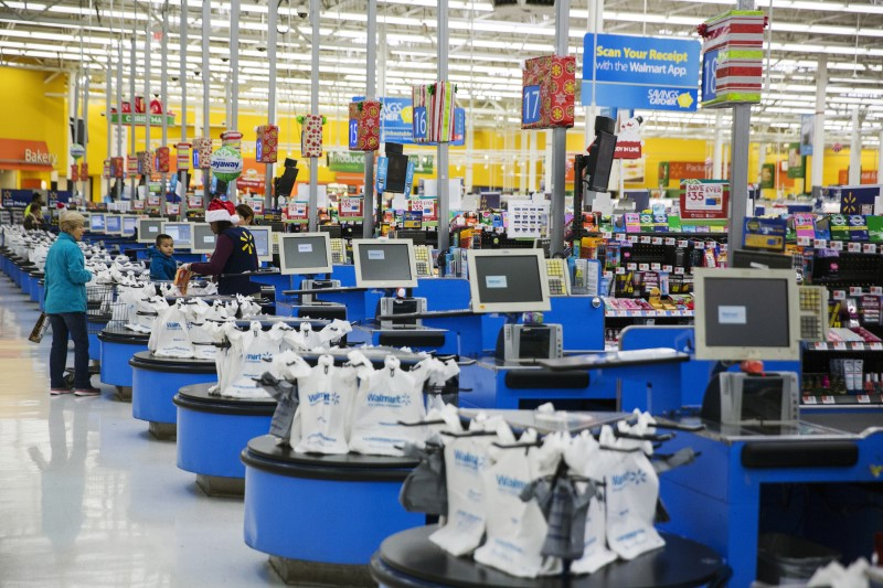 Employees work at the checkout counters of a Walmart store in Secaucus, New Jersey, November 11, 2015.