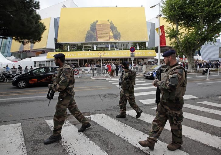 French soldiers patrol in front of the Festival Palace before the opening of the 69th Cannes Film Festival in Cannes