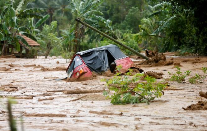 A trishaw is seen stuck in the mud at Elangipitiya village in Aranayaka, Sri Lanka May 19, 2016.