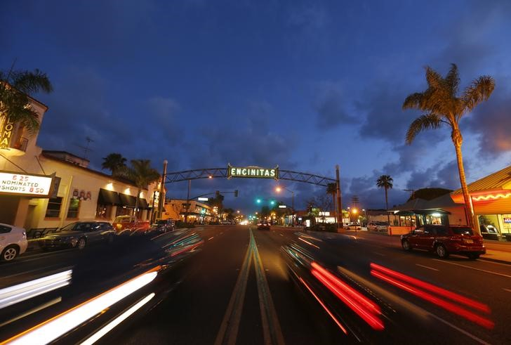 Traffic flows along Coast Highway 101 through San Diego's North County beach town of Encinitas, California