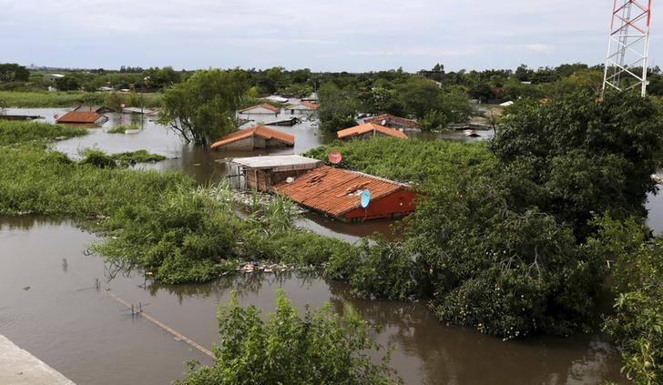 Houses are seen partially submerged in floodwaters in Asuncion