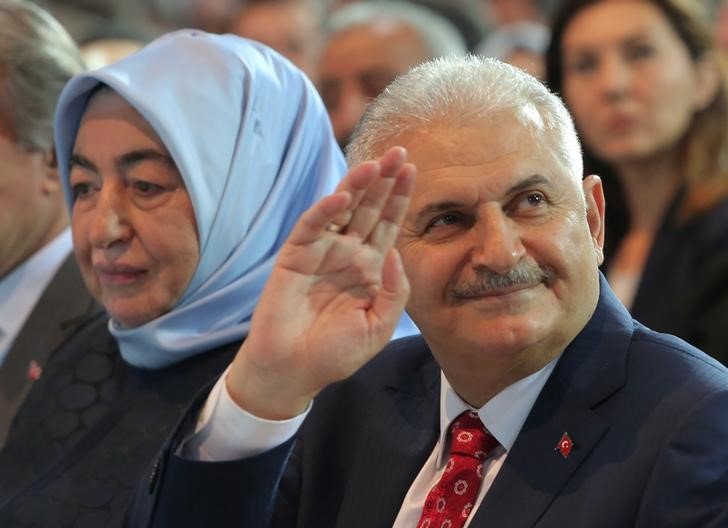 Turkey's Transportation Minister Yildirim greets members of his party during the AKP extraordinary