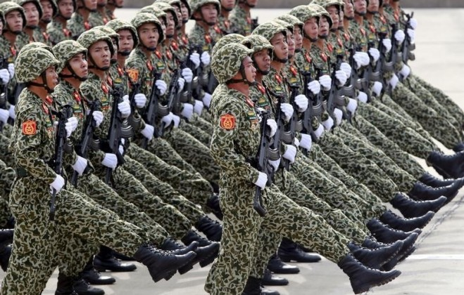 Vietnamese soldiers of a commando unit march during a parade marking their 70th National Day at Ba Dinh square in Hanoi,