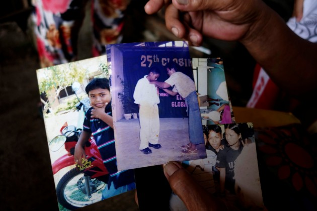 Clarita Alia shows photos of Fernando, one of four sons which have died in execution-style killings in Davao