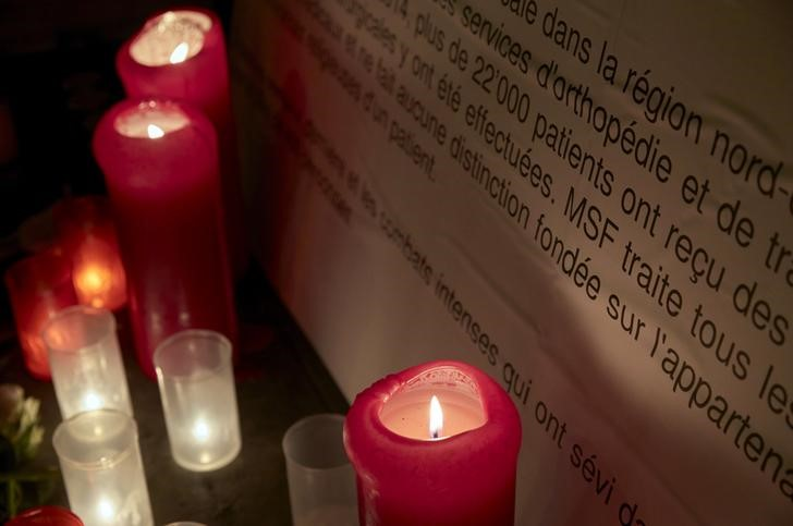 Candles are pictured outside the Medecins Sans Frontieres (MSF) headquarters in Geneva, Switzerland