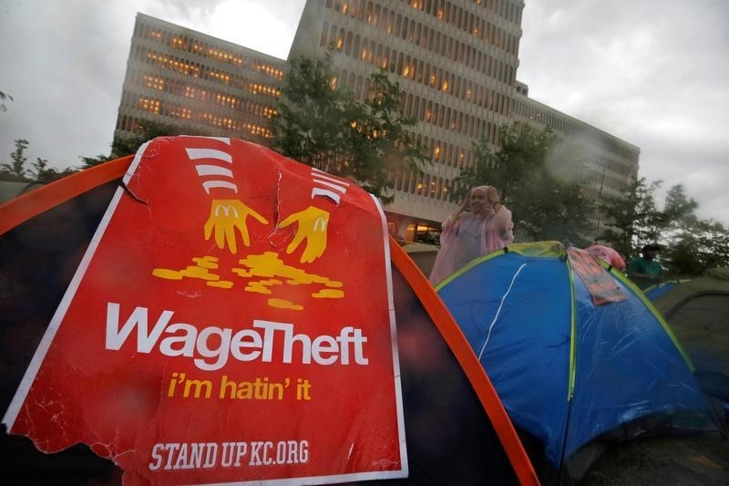 Protesters set up tents on the street as they demonstrate outside the McDonald's headquarters calling for higher wages and improved working conditions in the Chicago suburb of