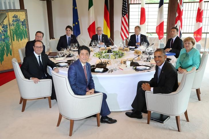 Participants of the G7 summit meetings (from front in clockwise) Japanese Prime Minister Shinzo Abe, French President Francois Hollande, Britain's Prime Minister David Cameron, Canadian Prime Minister Justin Trudeau, European Commission President Jean-Claude Juncker, European Council President Donald Tusk, Italy's Prime Minister Matteo Renzi, German Chancellor Angela Merkel and U.S. President Barack Obama attend session 1 working lunch meeting at the Shima Kanko Hotel in Shima, Mie Prefecture, Japan