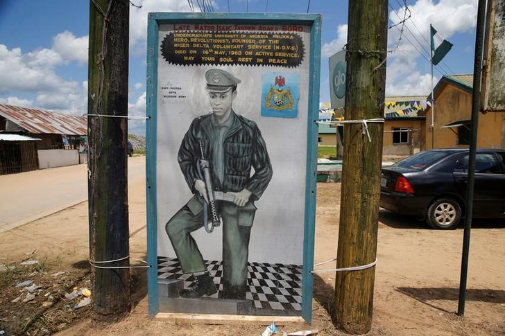 A painting depicting Isaac Adaka Boro, a former Niger Delta militant in the 1960s, is seen along a road in the village of Kiama near Yenagoa