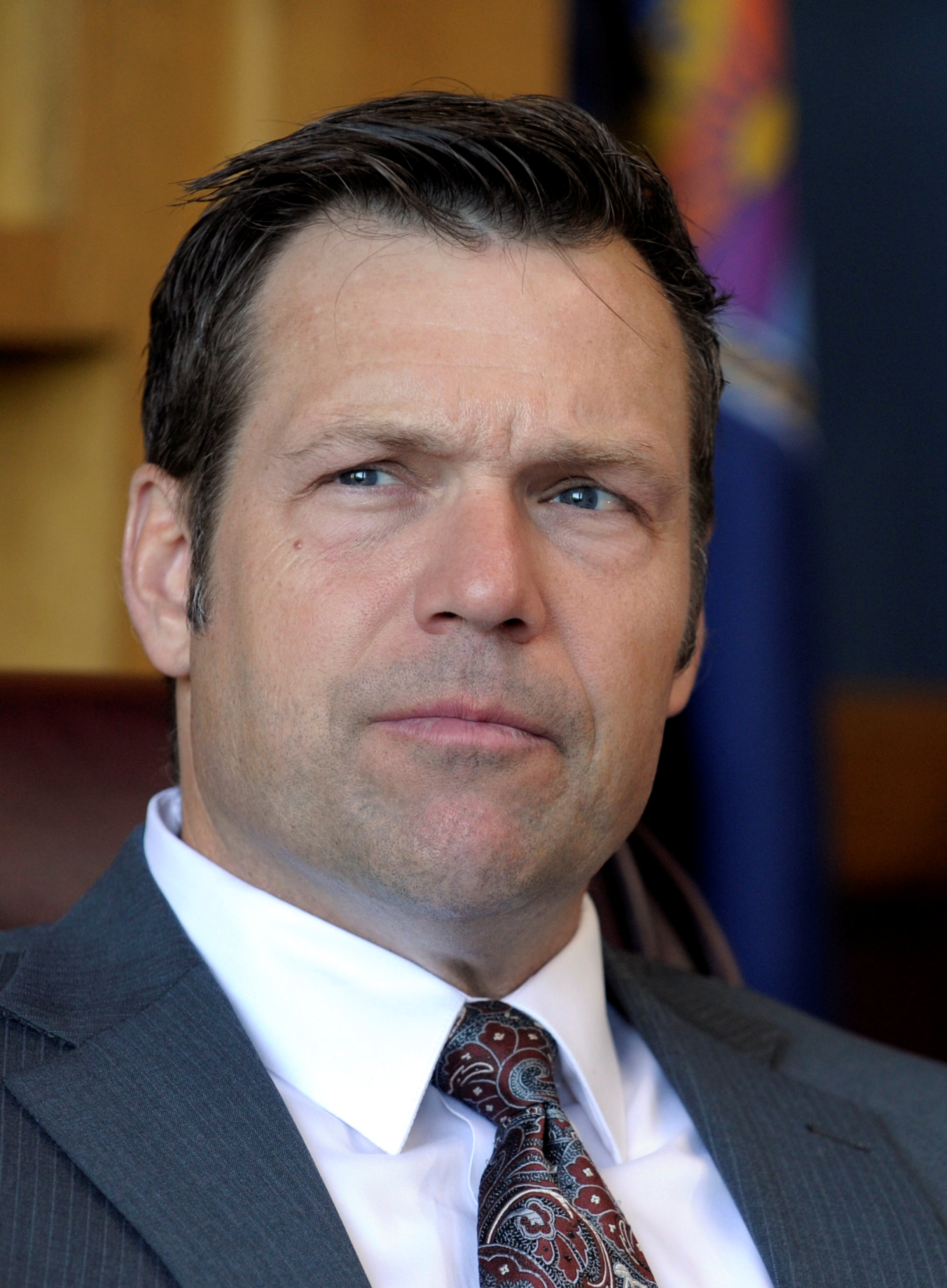 Kansas Secretary of State Kobach looks on as he talks about the Kansas voter ID law in his Topeka, Kansas office