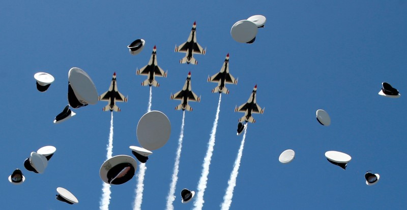 The Thunderbirds perform a fly-over as graduates from the Air Force Academy toss their hats in the air at the conclusion of their commencement ceremony in Colorado Springs