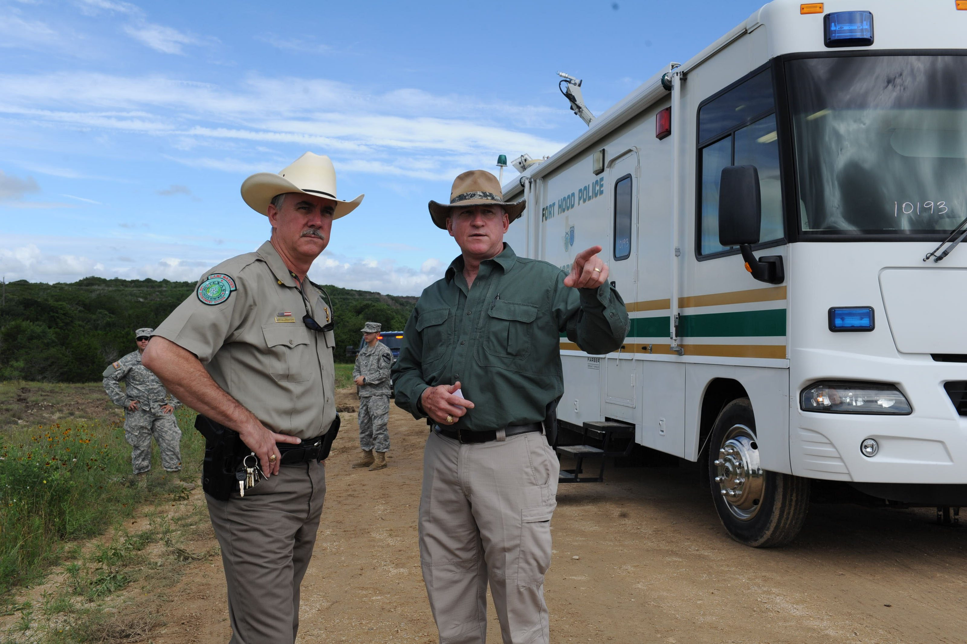 Texas Game Warden Jeff Gillenwaters and Chris Zimmer, deputy director for Fort Hood's Directorate of Emergency Services, discuss search and recovery efforts for four missing soldiers in Fort Hood