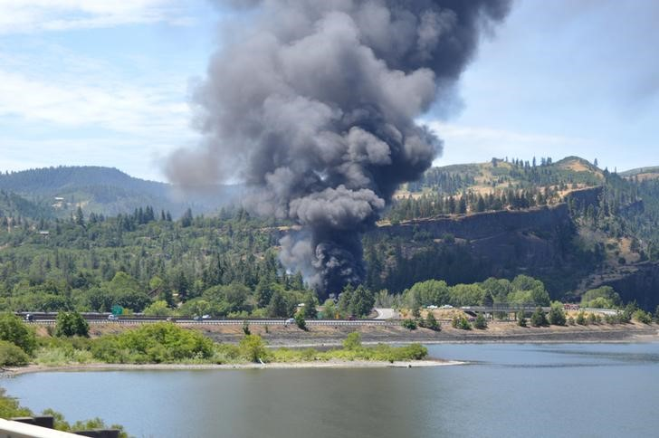Handout photo of smoke billowing from a derailed oil train near Mosier, Oregon