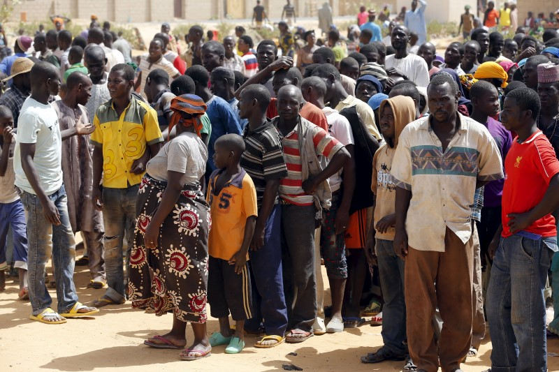 Nigerian refugees and other people displaced by the Boko Haram insurgence stand in queues after arriving in Nigeria, at Geidam, Nigeria