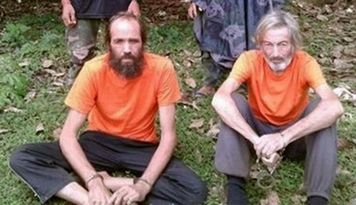 Hostages Canadian national Robert Hall and Norwegian national Kjartan Sekkingstad are seen in this undated picture released to local media, in Jolo