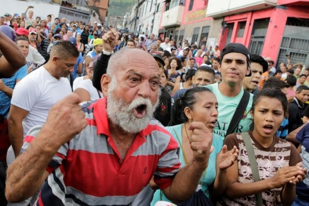 A man shouts during a protest over food shortage and against Venezuela's government in Caracas