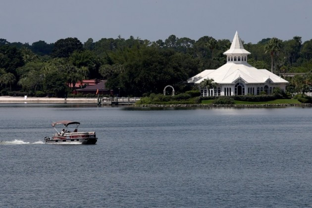 A search boat is seen in the Seven Seas Lagoon, in front of a beach at the Grand Floridian, at the Walt Disney World resort in Orlando, Florida