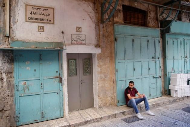 Christian man sitting in Jerusalem's Old City