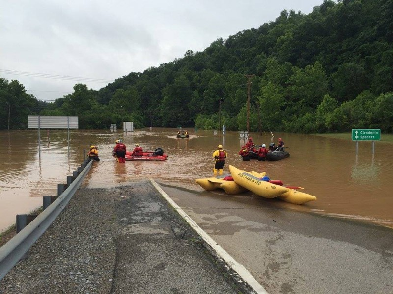 Emergency crews take out boats on a flooded I-79 at the Clendenin Exit, after the state was pummeled by up to 10 inches of rain on Thursday, causing rivers and streams to overflow into neighboring communities, in Kanawha County, West Virginia, June 24, 2016.