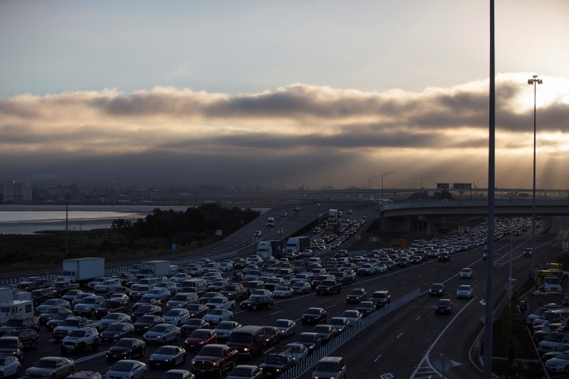 Motorists wait in line to cross the San Francisco-Oakland Bay bridge during morning commute hours in Oakland, California