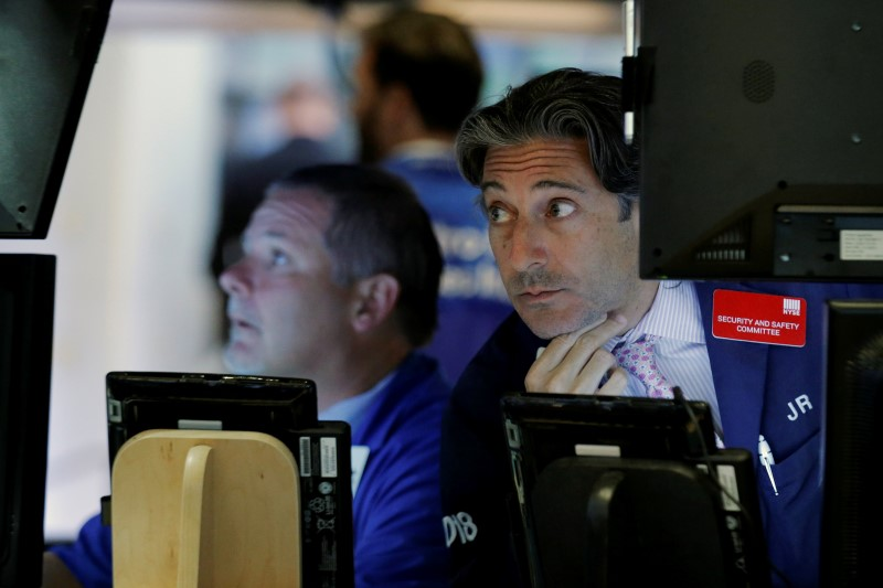 Traders work on the floor of the New York Stock Exchange (NYSE) in New York City, U.S.